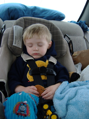 Tristen sleeping in car seat.